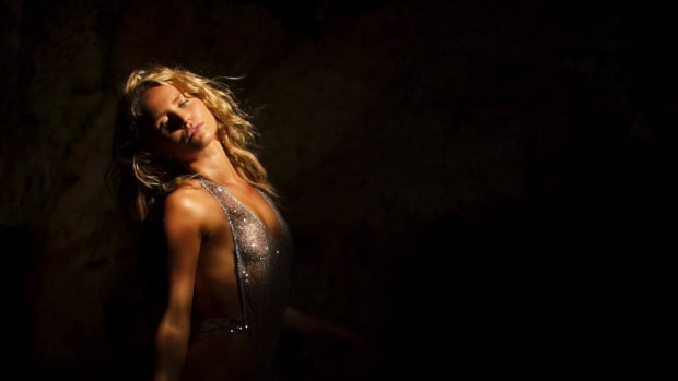 Sailor Brinkley Cook shines in a cave in Aruba.