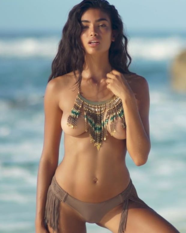 Kelly Gale wears nothing but a necklace on the beach