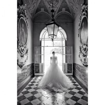 chrissy-teigen-wedding-dress-photos2-e1403012602910.jpg