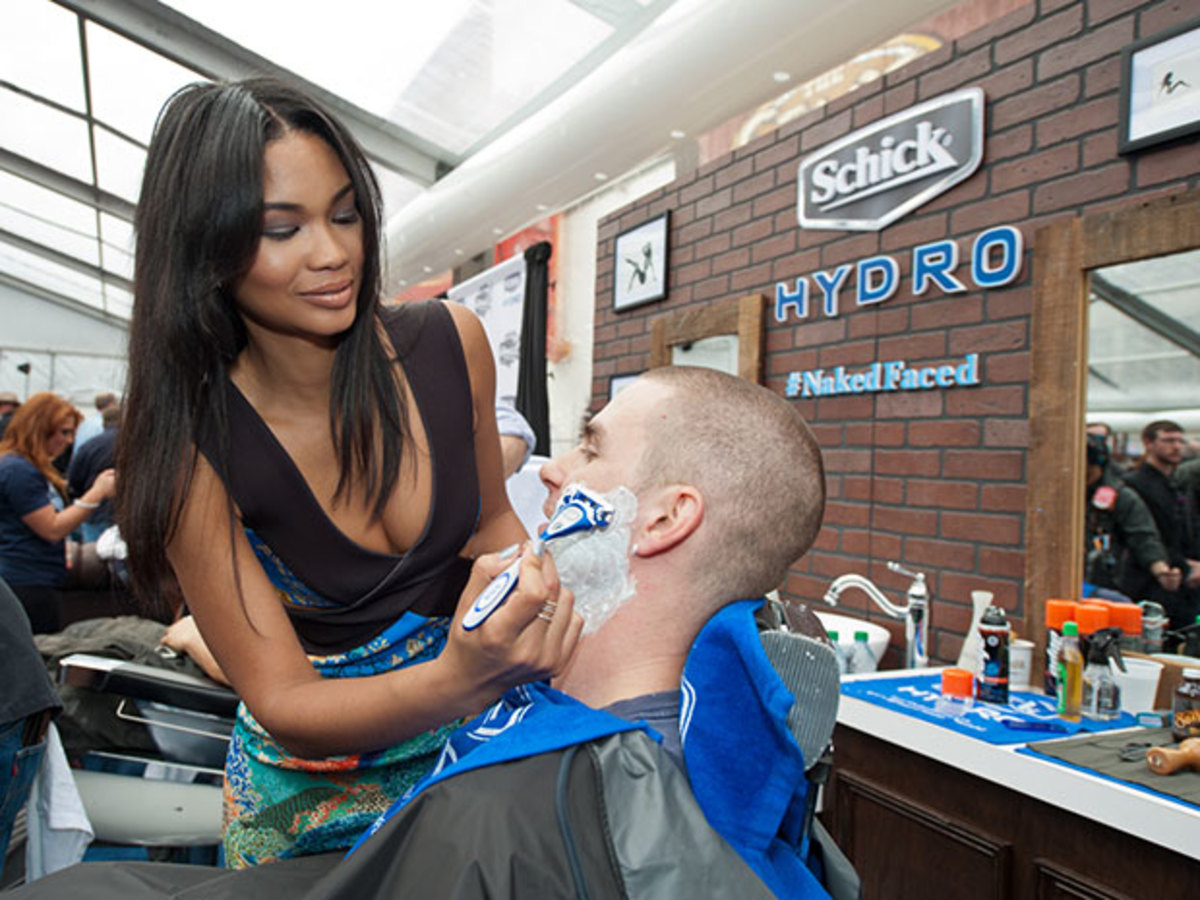 Chanel Iman gives a Nashville firefighter a smooth shave