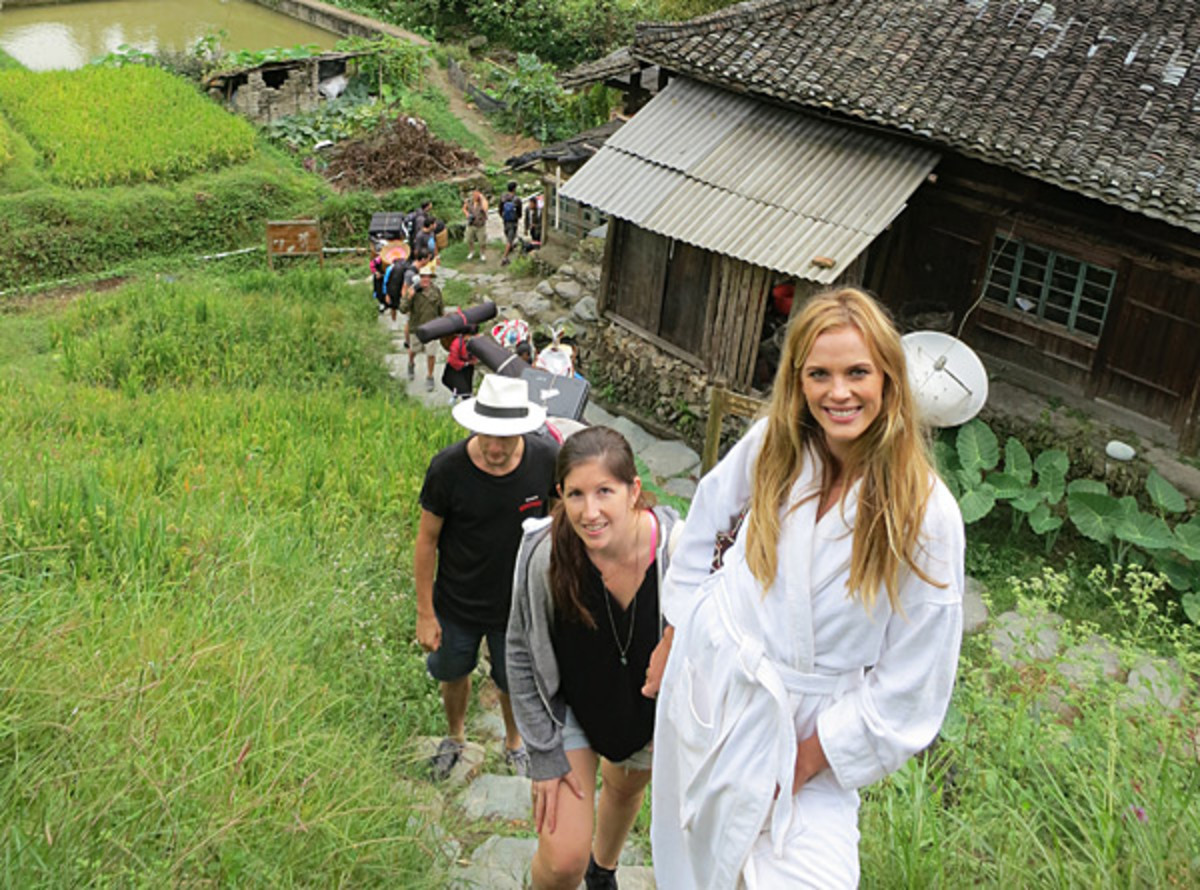 Anne V, Darcie and the crew hike to a location in China while shooting for the 2013 issue.