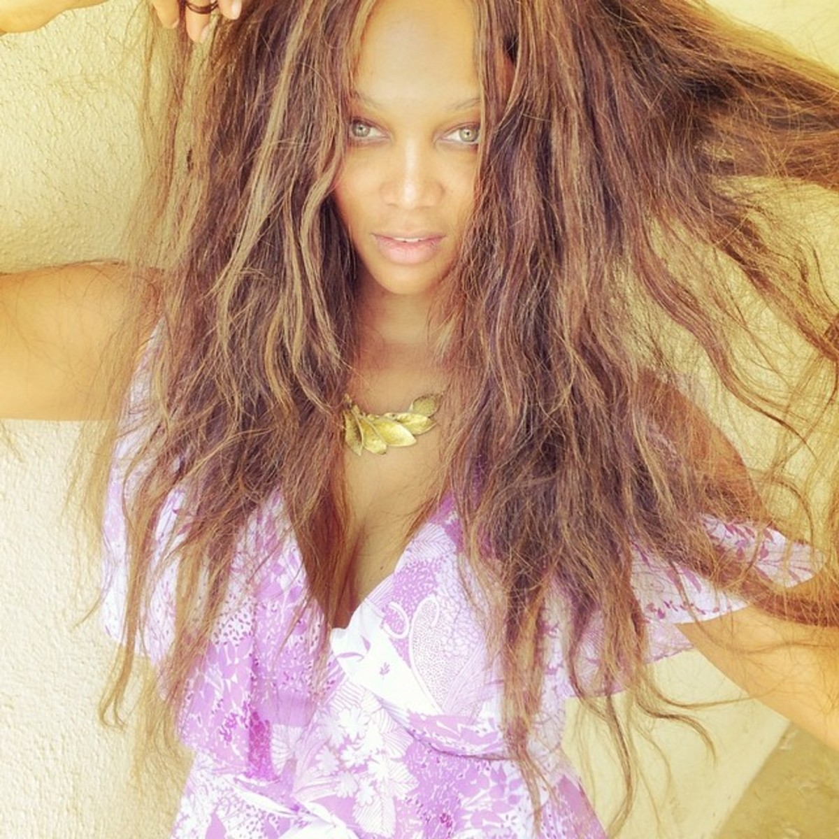 insta-tyrabanks-stand-against-wall-pull-on-your-hair-or-weave-stare-into-lens-think-about-something-that-makes-you-happy-then-click.jpg