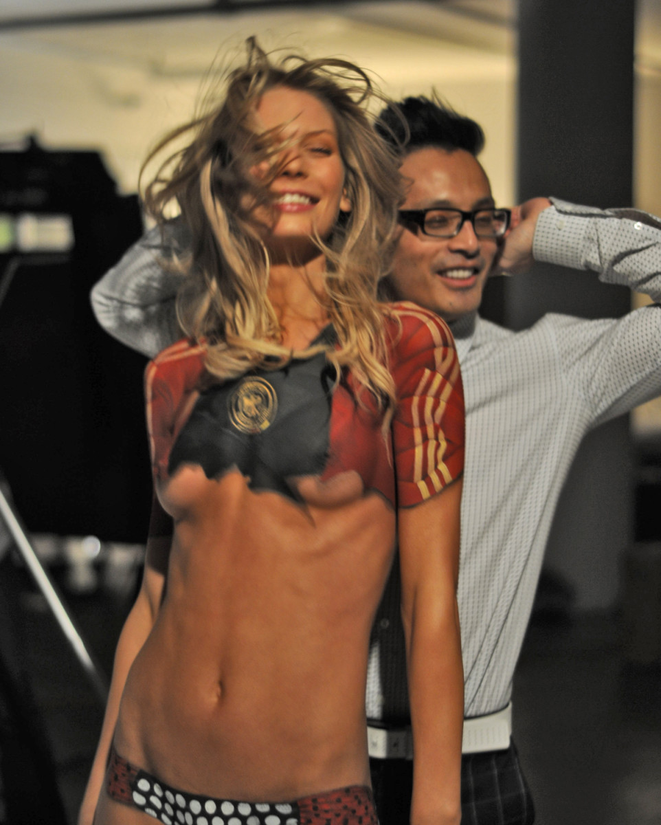 Sarah Brandner (with photographer Yu Tsai) in body paint, SI Swimsuit 2010