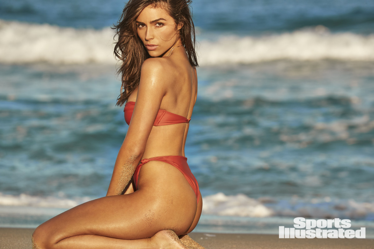 Olivia Culpo photographed by Ben Watts in Hollywood, Fla. Swimsuit by Tropic of C. Necklace by Jacquie Aiche.
